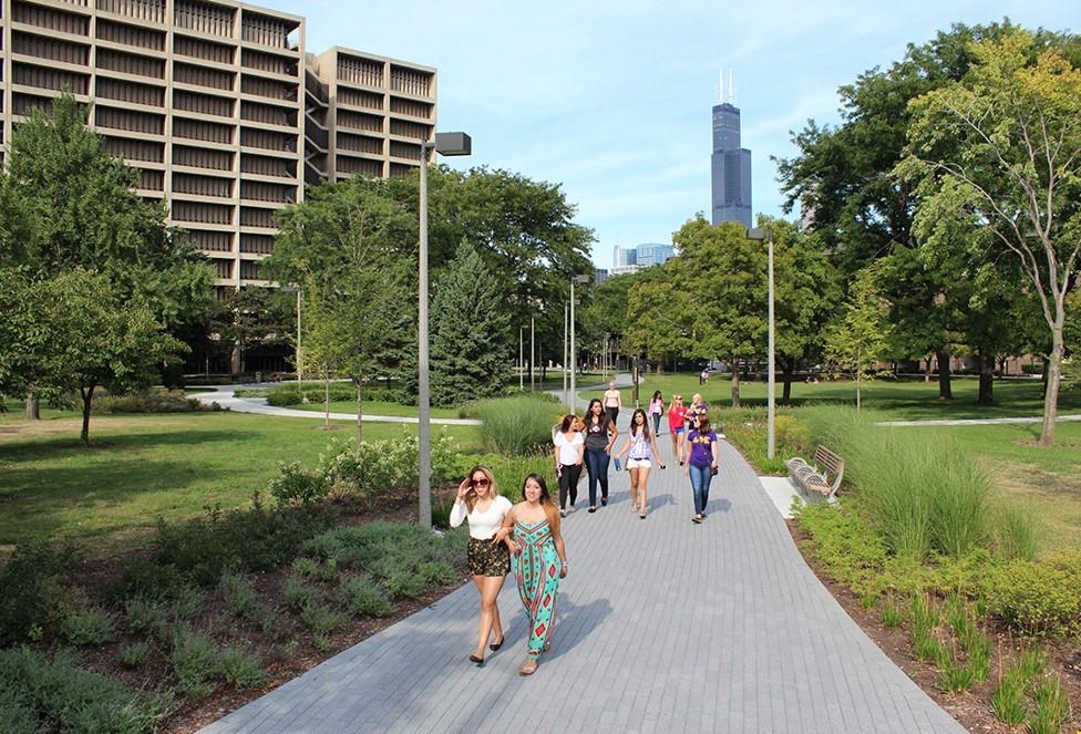 people walking path on uic campus around bioengineering building