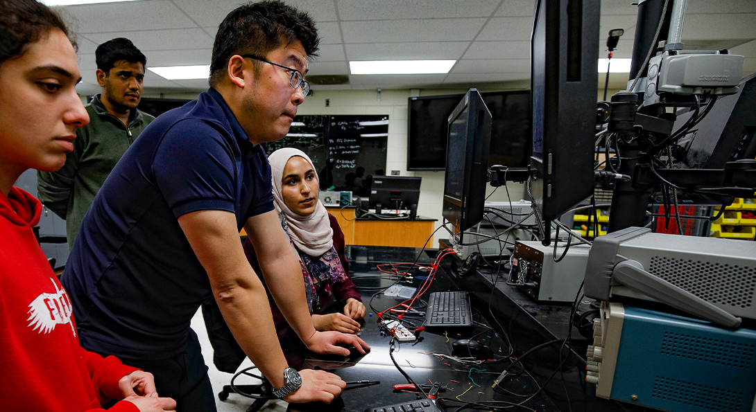 Teacher and Students on Computer